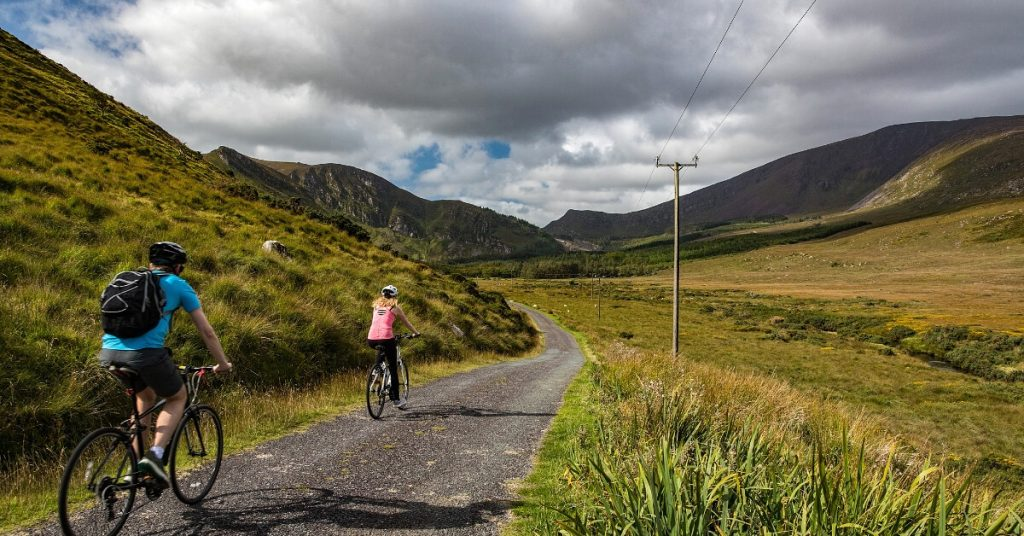 Cycling on a quiet country road on the Dingle Peninsula, Kerry, Ireland
