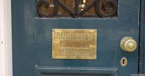 The shiny brass letterbox and door knob of the Grand Lodge of Freemasons, Dublin, Ireland