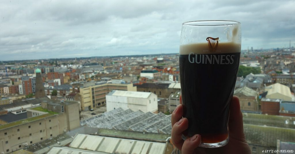 A pint of Guinness with a view of Dublin from the Gravity Bar