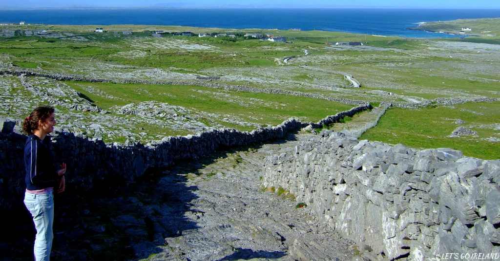 Emer viewing the stone walls on Inis Meáin (Inishmaan) on the Aran Islands, Ireland