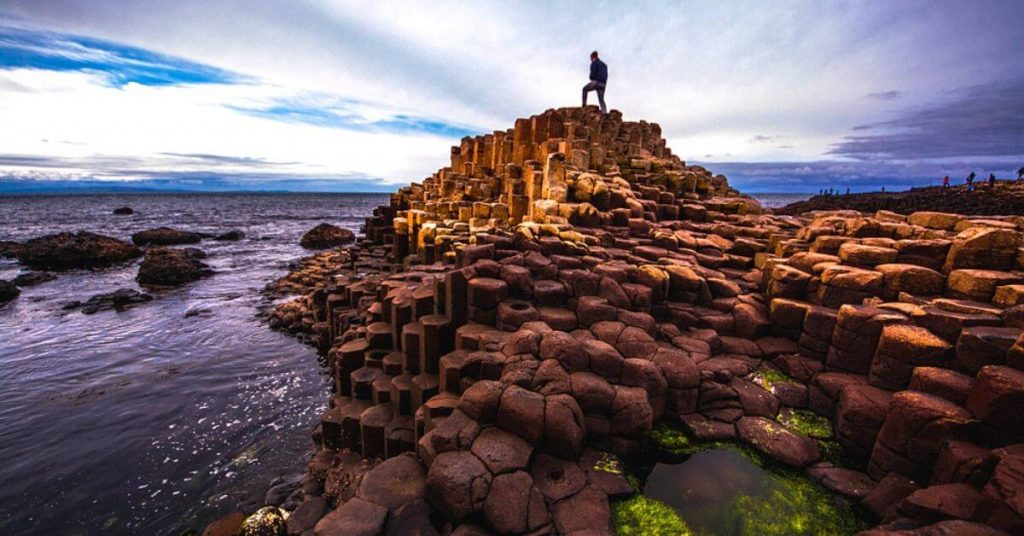 Person admiring the view on  the Giant's Causeway, Northern Ireland.