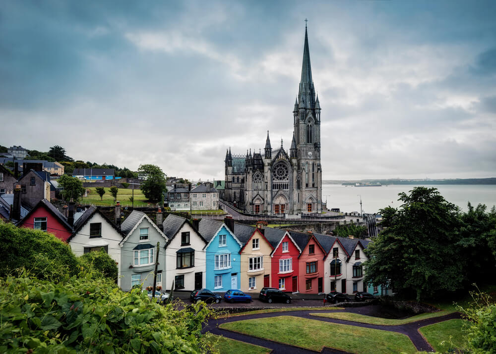 Cobh Cathedral and colorful houses, Cobh, County Cork, Ireland.