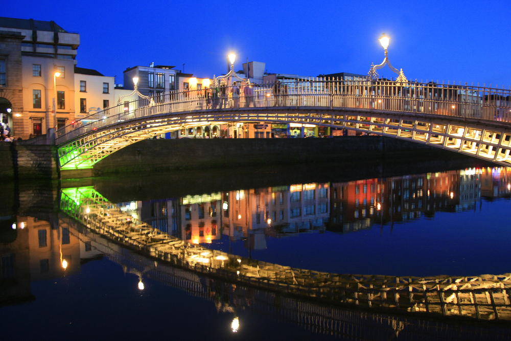 Ha'Penny Bridge in Dublin, Ireland at night.