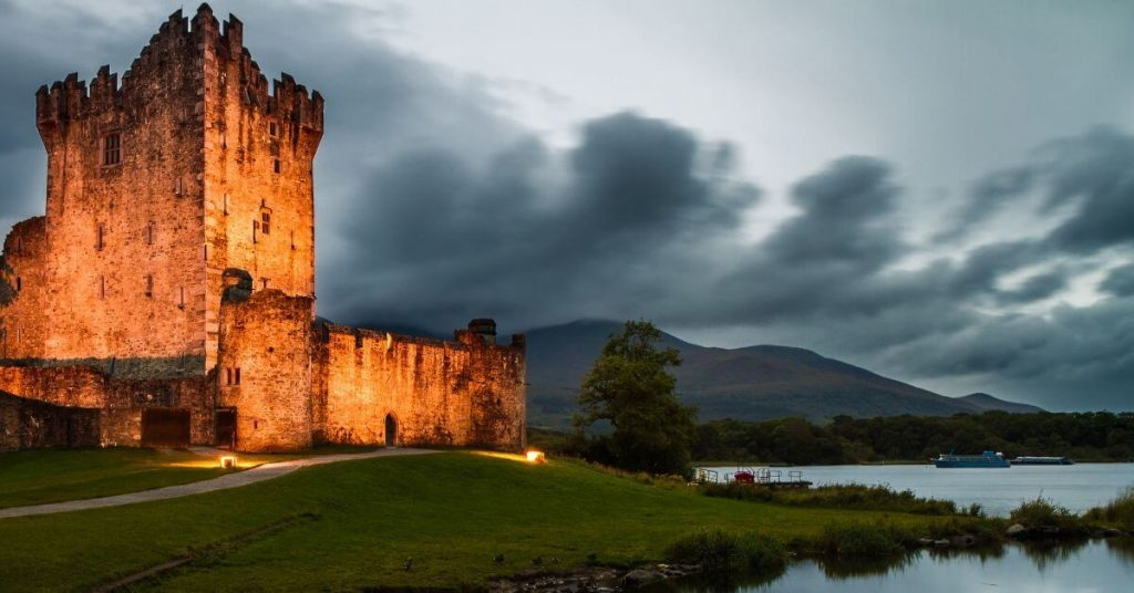 Ross Castle illuminated at dusk, Killarney, County Kerry, Ireland