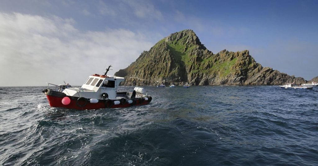 boat in front of Skellig Michael County Kerry Ireland