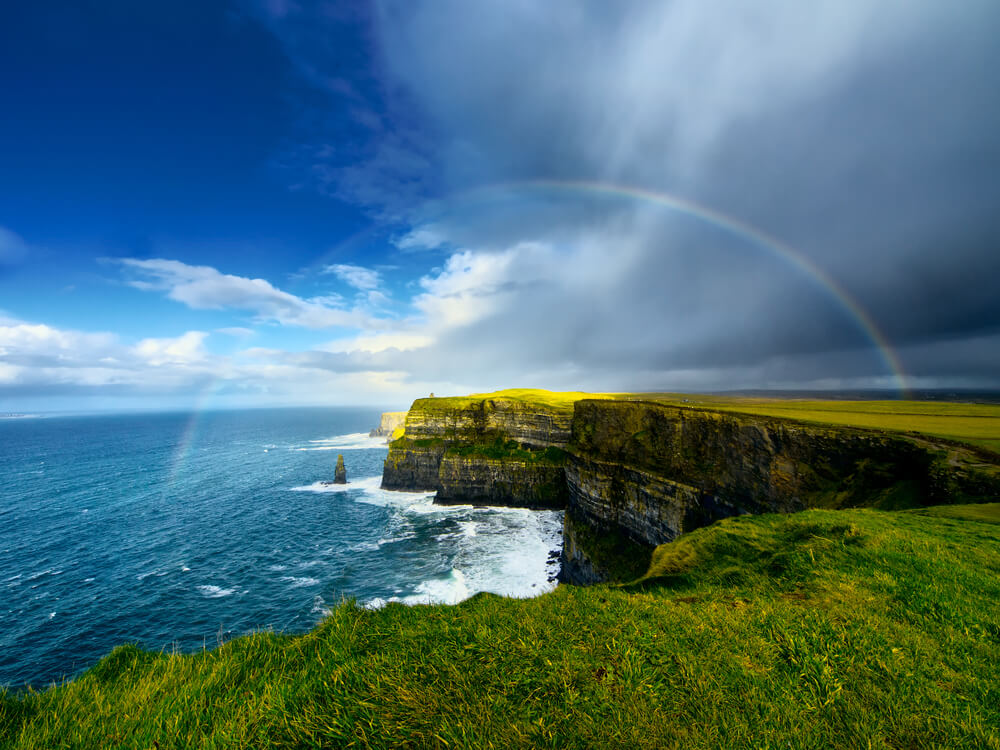 Cliffs of Moher in Ireland with a rainbow