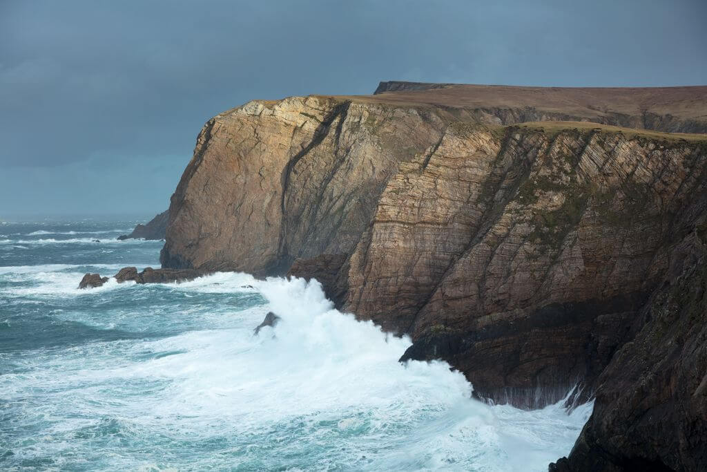 Winter waves crashing off the cliffs at Benwee Head, County Mayo, Ireland