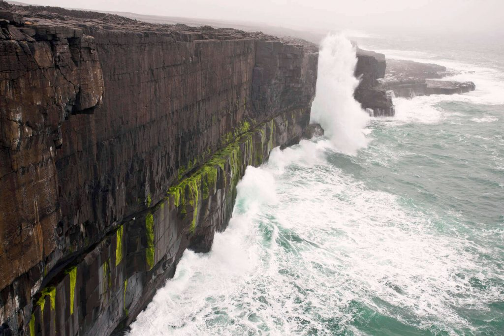 Stormy weather and big waves crash against Inis Mór, one of the Aran Islands off the coast of County Galway.