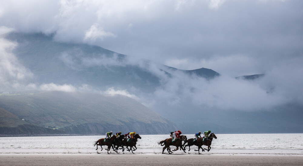 A gray day in Ireland with horse racing on the beach.