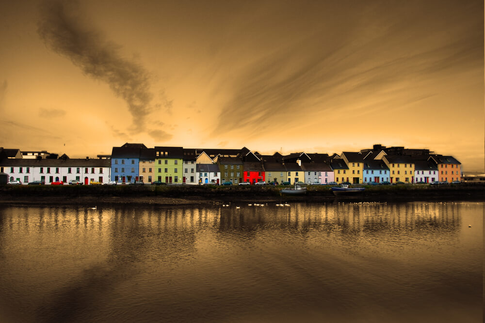 Colorful houses in Galway, Ireland on the banks of the River Corrib.