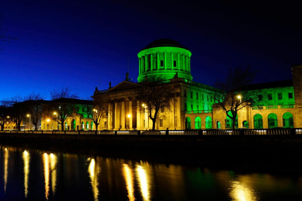 The Four Courts in Dublin, Ireland illuminated in green to celebration St. Patrick's Day.